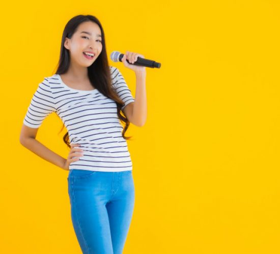 young-asian-woman-singing-with-microphone_74190-10882